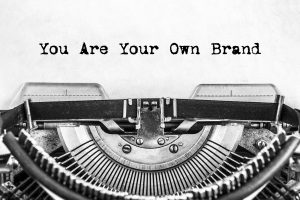 You Are Your Own Brand text typed on a vintage typewriter, old paper. close-up